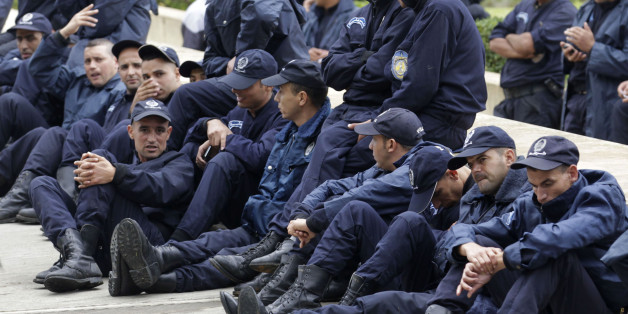Police officers gather near the Presidential Palace in Algiers October 15, 2014. Nearly a thousand Algerian policemen staged a sit-in outside President Abdelaziz Bouteflika's office in Algiers on Wednesday, demanding better working conditions. REUTERS/Louafi Larbi (ALGERIA - Tags: POLITICS LAW BUSINESS EMPLOYMENT CIVIL UNREST)