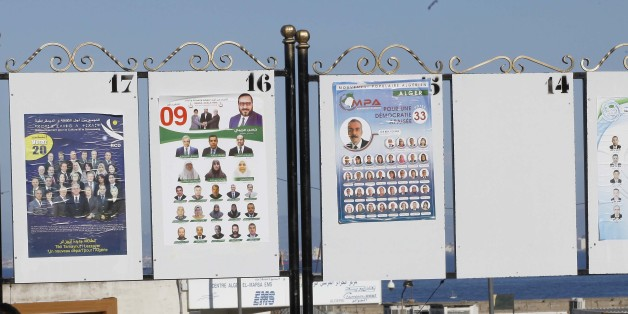 People sit under electorial campaign posters for the upcoming legislative elections in Algiers centers, Algeria, on April 12 , 2017. (Photo by Billal Bensalem/NurPhoto via Getty Images)