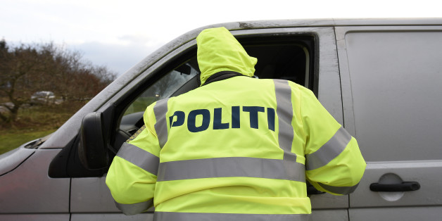 A Danish policeman checks a vehicle at a checkpoint on the German-Danish border crossing in Froslev, January 4, 2016.  REUTERS/Fabian Bimmer