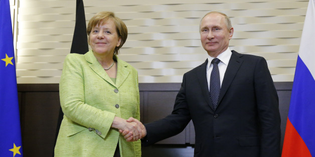 Russian President Vladimir Putin and German Chancellor Angela Merkel shake hands prior to their talks at the Bocharov Ruchei state residence in Sochi, Russia, May 2, 2017. REUTERS/Alexander Zemlianichenko/Pool