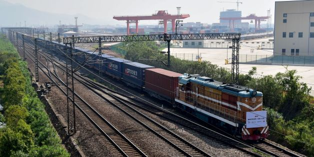 A freight train transporting containers laden with goods from London, arrives at Yiwu railway port station in Yiwu, east China's Zhejiang province on April 29, 2017. Laden with whisky and baby milk, the first freight train linking China directly to the UK arrived in the eastern Chinese city of Yiwu on April 29 after a 12,000-kilometre (7,500-mile) trip, becoming the world's second-longest rail route. / AFP PHOTO / STR / China OUT        (Photo credit should read STR/AFP/Getty Images)