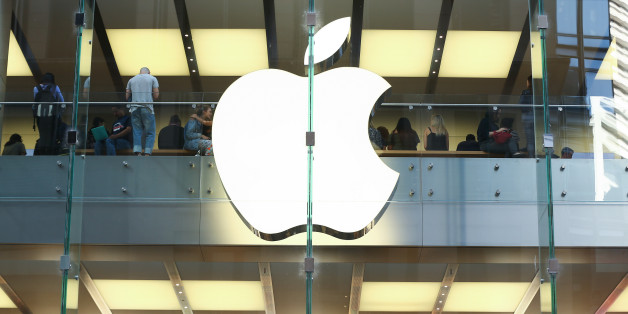 Customers are seen inside an Apple Inc. store in Sydney, Australia, on Thursday, April 13, 2017. The Australian economy will expand 2.5 percent in 2017, 2.8 percent in 2018 and 2.6 percent in 2019, according to a survey conducted by Bloomberg News. Photographer: Brendon Thorne/Bloomberg via Getty Images