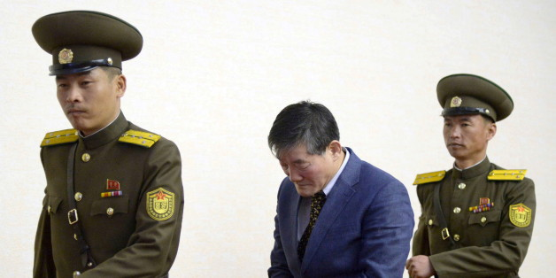 A man (C) who identified himself as Kim Dong Chul, previously said he was a naturalised American citizen and was arrested in North Korea in October, leaves after a news conference in Pyongyang, North Korea, in this photo released by Kyodo March 25, 2016. The Korean-American man who had been detained in North Korea has confessed to trying to steal military secrets from the isolated state, Japan's Kyodo and China's Xinhua news agencies reported on Friday. Mandatory credit REUTERS/Kyodo ATTENTION E