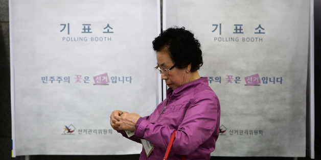 SEOUL, SOUTH KOREA - MAY 04:  A South Korean woman leaves after casting her preliminary vote in a polling station on May 4, 2017 in Seoul, South Korea. Preliminary voting has started at local polling stations across South Korea prior to the primary Presidential election on May 9,  2017.  (Photo by Chung Sung-Jun/Getty Images)