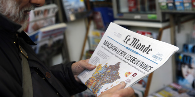 PARIS, FRANCE - APRIL 24:  A man looks at the front page of the French newspaper 'Le Monde' a day after the first round of the French Presidential election on April 24, 2017 in Paris, France. Macron topped April 23's first round with 23.7 percent and National Front (FN) leader Le Pen with 21.9 percent, according to near-final results from the interior ministry.  (Photo by Chesnot/Getty Images)