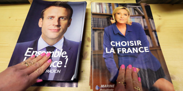 Civil servants prepare electoral documents for the upcoming second round of 2017 French presidential election as registered voters will receive an envelope containing the declarations of faith of each candidate, Emmanuel Macron (R) and Marine Le Pen along with the two ballot papers for the May 7 second round of the French presidential election, in Nice, France, May 3, 2017. REUTERS/Eric Gaillard