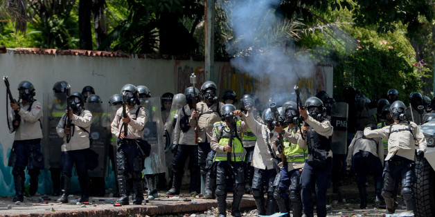 Riot police crack down on students at the Central University of Venezuela during clashes in a protest against the government of Nicolas Maduro in Caracas on May 4, 2017.Anti-government protests raged on in Venezuela Thursday as students launched fresh marches after a day of flames and tear gas brought the death toll to 33. / AFP PHOTO / FEDERICO PARRA        (Photo credit should read FEDERICO PARRA/AFP/Getty Images)