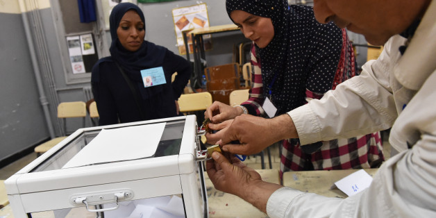 Scrutineers count votes at the end of the Algerian parliamentary elections late on May 4, 2017, in the capital Algiers. / AFP PHOTO / RYAD KRAMDI        (Photo credit should read RYAD KRAMDI/AFP/Getty Images)