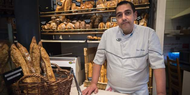 French artisan baker Sami Bouattour of Boulangerie Brun, who was awarded the Grand Prize for Paris' Best Baguette, poses in his bakery in Paris on May 5, 2017. / AFP PHOTO / Lionel BONAVENTURE        (Photo credit should read LIONEL BONAVENTURE/AFP/Getty Images)