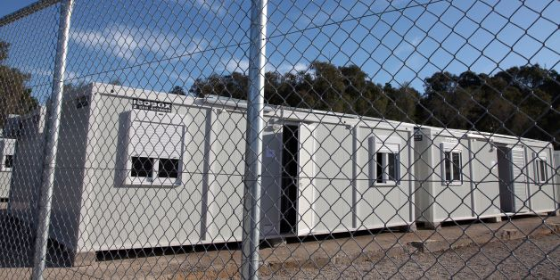 A picture shows prefabricated houses in a registration centre for migrants and refugees on the Greek island of Leros on February  16, 2016.Greece on February 16 hit back at EU criticism of its handling of the massive migrant influx, saying the time for blaming Athens was 'over' as it prepared to open new centres to register refugees, including four on frontline islands. / AFP / ILIANA MIER        (Photo credit should read ILIANA MIER/AFP/Getty Images)