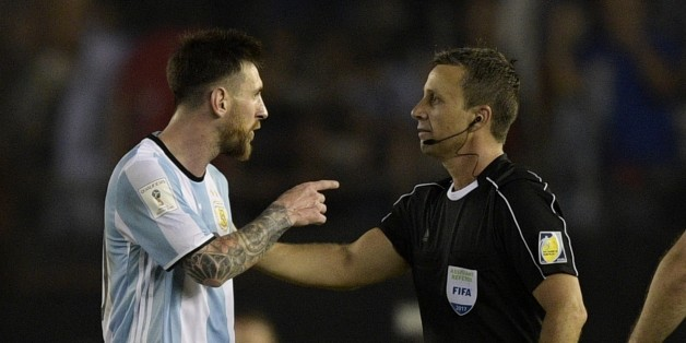 Argentina's forward Lionel Messi (L) argues with first assistant referee Emerson Augusto de Carvalho at the end of their 2018 FIFA World Cup Russia South American qualifier football match against Chile, at the Monumental stadium in Buenos Aires, on March 23, 2017. The FIFA on March 28, 2017 suspended Messi for four Argentina games. / AFP PHOTO / JUAN MABROMATA        (Photo credit should read JUAN MABROMATA/AFP/Getty Images)