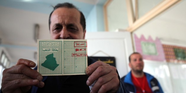 An Algerian man show his electoral card at a polling station in Algiers, Algeria  on May 4, 2017 during parliamentary elections. Algerians voted for a new parliament amid soaring unemployment and a deep financial crisis caused by a collapse in oil revenues.  (Photo by Billal Bensalem/NurPhoto via Getty Images)