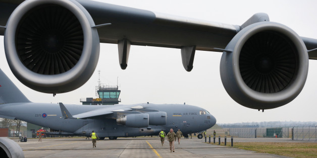 A broken down Royal Air Force C-17 stands in the foreground as another prepares to be loaded with French military equipment at Evreux in northern France, January 14, 2013. Britain is lending logistical support to France as it sends troops and military equipment to Mali.  REUTERS/Andrew Winning (FRANCE - Tags: MILITARY POLITICS)