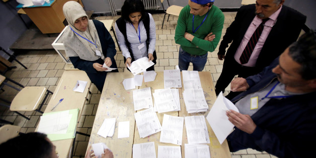 Election workers count ballots at the end of voting for the parliamentary election in Algiers, Algeria, May 4, 2017. REUTERS/Ramzi Boudina