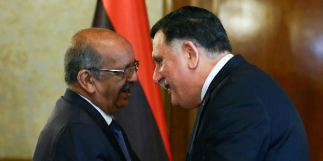 Algeria's Minister Delegate for Maghreb and African Affairs, Abdelkader Messahel (L), shakes hands with with Libyan Prime Minister Fayez al-Sarraj in the capital Tripoli on April 21, 2017. / AFP PHOTO / MAHMUD TURKIA        (Photo credit should read MAHMUD TURKIA/AFP/Getty Images)