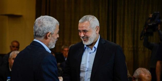 DOHA, QATAR - MAY 1: Deputy Head of Political bureau of Hamas, Ismail Haniyeh (R) shakes hands with  Leader of Hamas in the Gaza Strip Yahya Sinwar (L) during the meeting of the Hamas officials as Chairman of the Hamas Political Bureau, Khaled Mashal (not seen) expresses new vision and policy of Hamas, in Doha, Qatar on May 1, 2017. (Photo by Mustafa Hassona/Anadolu Agency/Getty Images)