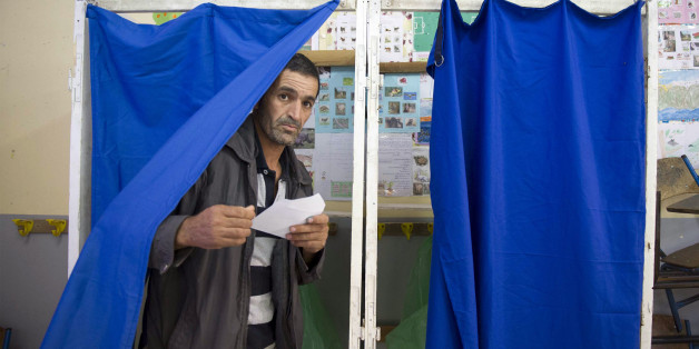 An Algerian man casts his vote at a polling station in the town of Blida, 45 kilometres (30 miles) southwest of Algiers, on May 4, 2017 during parliamentary elections.Algerians voted for a new parliament amid soaring unemployment and a deep financial crisis caused by a collapse in oil revenues. / AFP PHOTO / stringer        (Photo credit should read STRINGER/AFP/Getty Images)
