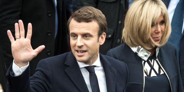 French presidential election candidate for the En Marche ! movement Emmanuel Macron waves to supporters next to his wife Brigitte Trogneux on May 7, 2017, in Le Touquet, northern France, after voting for the second round of the French presidential election. / AFP PHOTO / PHILIPPE HUGUEN        (Photo credit should read PHILIPPE HUGUEN/AFP/Getty Images)