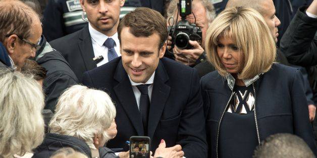 French presidential election candidate for the En Marche ! movement Emmanuel Macron (C), next to his wife Brigitte Trogneux (R), speaks with supporters in Le Touquet, northern France, on May 7, 2017, after voting for the second round of the French presidential election. / AFP PHOTO / PHILIPPE HUGUEN        (Photo credit should read PHILIPPE HUGUEN/AFP/Getty Images)