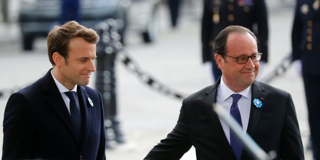 Outgoing French President Francois Hollande (R) touches the arm of President-elect Emmanuel Macron (L) as they stand at the Tomb of the Unknown Soldier at the Arc de Triomphe during a ceremony marking the 72nd anniversary of the victory over Nazi Germany during World War II on May 8, 2017 in Paris. / AFP PHOTO / POOL / PHILIPPE WOJAZER        (Photo credit should read PHILIPPE WOJAZER/AFP/Getty Images)
