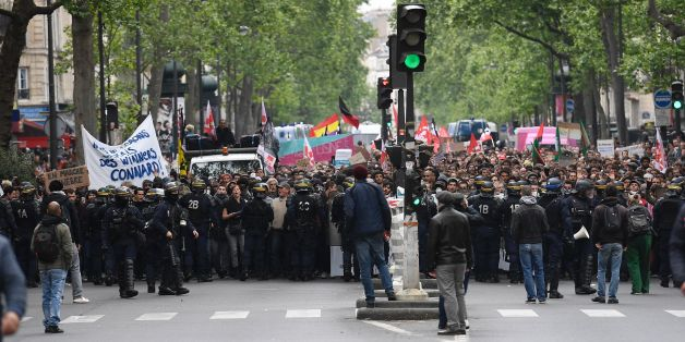 Riot police officers block a street while people take part in a demonstration called by the collectif 'Front Social' and labour unions on May 8, 2017 a day after the French presidential election. / AFP PHOTO / Lionel BONAVENTURE        (Photo credit should read LIONEL BONAVENTURE/AFP/Getty Images)