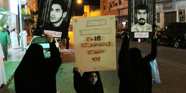 "Protesters hold posters of prisoners during a protest in Qatif March 9, 2011. Saudi Shi'ites staged another small protest in the kingdom's eastern province on Wednesday, defying a ban on demonstrations. More than 100 mostly young men gathered in the main Shi'ite city of Qatif on the Gulf coast to demand the release of prisoners they say are held without trial, witnesses said. Banner reads: ""Forgotten, in prison 16 year"". REUTERS/Stringer (SAUDI ARABIA - Tags: POLITICS CIVIL UNREST)"