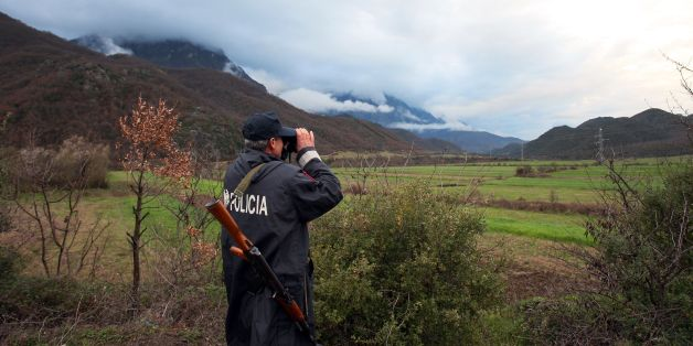 An Albanian police officer patrols at the Albanian-Greek border in Carshove near the city of Permet on March 15, 2016.EU interior ministers were set to meet in Brussels on March 17, 2016 to discuss the migrant crisis after western Balkan nations slammed shut their borders, exacerbating a dire humanitarian situation on the Macedonian frontier. Along with Bulgaria, others concerned include Italy, worried not only about a possible new influx of migrants from lawless Libya but also about people arri