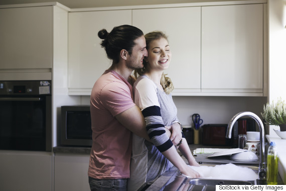 couple wash dishes