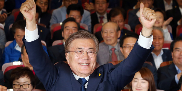 Moon Jae-in, the presidential candidate of the Democratic Party of Korea, speaks to the media after voting at a polling station in Seoul, South Korea, May 9, 2017. REUTERS/Kim Kyung-Hoon