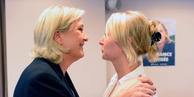 French far-right Front National (FN) party President and member of the European Parliament Marine Le Pen (L) greets her niece FN MP Marion Marechal-Le Pen after delivering a press conference in Nanterre, near Paris, on July 16, 2016, regarding the July 14 attack in Nice.
