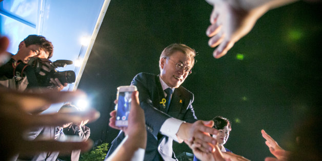 SEOUL, SOUTH KOREA - MAY 09:  Mr. Moon Jae-in, the president-elect, greets supporters after his victory was confirmed on the presidential election on May 9, 2017 in Seoul, South Korea. The liberal presidential candidate had some 6.25 million, or 39.5 percent, of the 15.88 million votes counted so far, according to the National Election Commission. (Photo by Jean Chung/Getty Images)