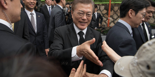 South Korean President Moon Jae-In greets supporters outside his home Seoul on May 10, 2017.Left-leaning former human rights lawyer Moon Jae-In began his five-year term as president of South Korea following a landslide election win after a corruption scandal felled the country's last leader.  / AFP PHOTO / Ed JONES        (Photo credit should read ED JONES/AFP/Getty Images)