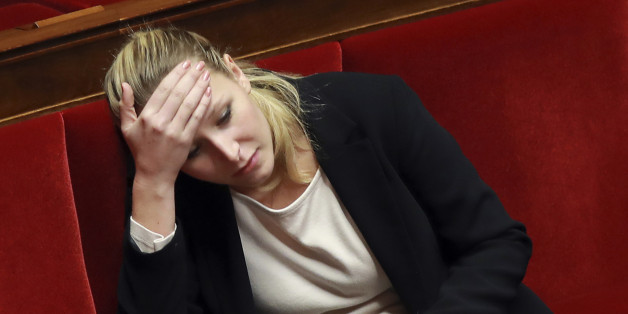 French MP Marion Marechal-Le Pen looks on during a session of the French National Assembly on a draft law on broaden the crime of obstruction of abortion to websites, on December 1, 2016 in Paris. / AFP / JACQUES DEMARTHON        (Photo credit should read JACQUES DEMARTHON/AFP/Getty Images)