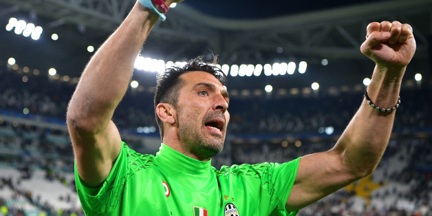 TURIN, ITALY - MAY 09:  Gianluigi Buffon of Juventus celebrates as a flyer for the Cardiff final flys infront of him after the UEFA Champions League Semi Final second leg match between Juventus and AS Monaco at Juventus Stadium on May 9, 2017 in Turin, Italy.  (Photo by Stuart Franklin/Getty Images)