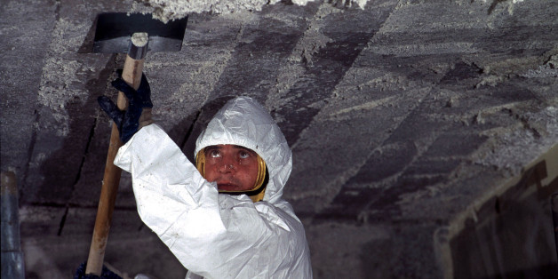 A worker removes asbestos (amiante) cement from the ceiling in a primary school in Nantes after France announced a ban on asbestos from 1997. A study predicted that some 2000 people would die this year from exposure to the industrial fibre.
