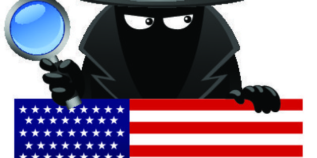 Vector illustration of a spy with magnifying glass behind an american flag