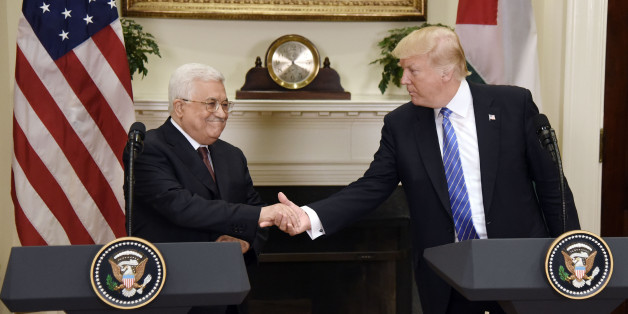 U.S. President Donald Trump shakes hands with Mahmoud Abbas, president of Palestine, left, during a joint press conference in the Roosevelt Room of the White House in Washington, D.C., U.S., on Wednesday, May 3, 2017. Trumpwelcomed Abbasto the White House on Wednesday as the U.S. president weighs how to approach a Middle East conflict that has eluded resolution for seven decades. Photographer: Olivier Douliery/Pool via Bloomberg