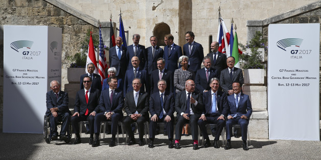 Financial ministers and bank governors pose for a family photo during the G7 for Financial ministers meeting in the southern Italian city of Bari, Italy May 13, 2017. REUTERS/Alessandro Bianchi