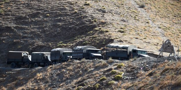 Algerian army troops carry out search operations in the mountainous eastern Tizi Ouzou region in a desperate bid to find French hiker Herve Gourdel who was kidnapped by militants linked to the Islamic State group who have threatened to execute him on September 23, 2014 near the village of Ait Ouaban, 80 km south of Tizi Ouzou. Paris vowed it would not negotiate with jihadists, as the local army raced against time to find him before his threatened execution.   AFP PHOTO / FAROUK BATICHE        (P