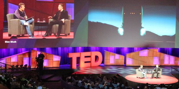 Tesla chief Elon Musk (R) provides a teasing glimpse at a self-driving cargo truck being developed by the California-based electric vehicle company during a chat with Chris Anderson (L) at a TED Conference in Vancouver, Canada, April 28, 2017.  / AFP PHOTO / Glenn CHAPMAN        (Photo credit should read GLENN CHAPMAN/AFP/Getty Images)