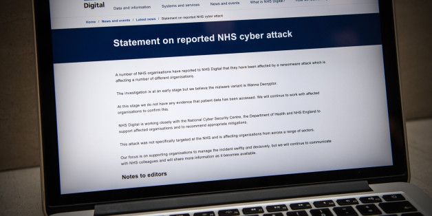LONDON, ENGLAND - MAY 12:  A message informing visitors of a cyber attack is displayed on the NHS website on May 12, 2017 in London, England. NHS hospitals across England have been hit by a large-scale cyber-attack with many hospitals having to divert emergency patients and doctors reporting messages demanding money.  (Photo by Carl Court/Getty Images)