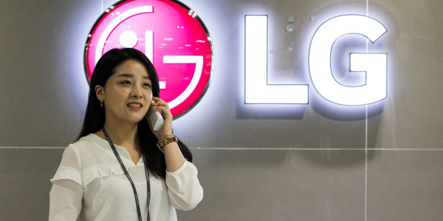 An LG Electronics Inc. employee speaks on the phone in the showroom of the company's factory in Changwon, South Korea, on Thursday, June 9, 2016. LG, with businesses spanning TVs to washing machines, is looking at home appliance acquisitions to fuel its global expansion and withstand a slowing smartphone market. Photographer: SeongJoon Cho/Bloomberg via Getty Images