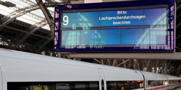 An electronic display calls on travellers to listen to the speaker announcements as a train stands on a platform of the train station in Leipzig, eastern Germany, on May 13, 2017.A fast-moving wave of cyberattacks swept the globe, apparently exploiting a flaw exposed in documents leaked from the US National Security Agency. Affected by the onslaught were computer networks at hospitals in Britain, Russia's interior ministry, the Spanish telecom giant Telefonica, the US delivery firm FedEx, German