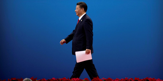 Chinese President Xi Jinping leaves the stage after speaking during the opening ceremony of the Belt and Road Forum at the China National Convention Center (CNCC) in Beijing, May 14, 2017. REUTERS/Mark Schiefelbein/Pool