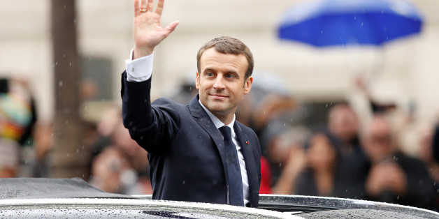 French President Emmanuel Macron waves from his car on the Champs Elysees avenue after the handover ceremony in Paris, France, May 14, 2017.      REUTERS/Francois Lenoir