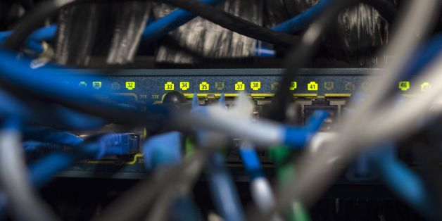 Network cables are seen going into a server in an office building in Washington, DC on May 13, 2017. International investigators hunted on May 13 for those behind an unprecedented cyber-attack that affected systems in dozens of countries, including at banks, hospitals and government agencies, as security experts sought to contain the fallout. The assault, which began Friday and was being described as the biggest-ever cyber ransom attack, struck state agencies and major companies around the world