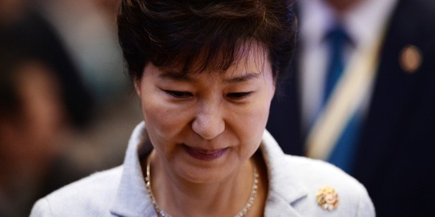 South Korean President Park Geun-hye attends the 17th ASEAN- Republic of Korea meeting during the 27th Association of Southeast Asian Nations ( ASEAN ) Summit at the Kuala Lumpur  on November 22, 2015. Southeast Asian leaders November 22 symbolically declared the establishment by year-end of an EU-style regional economic bloc, but diplomats admitted it will be years before the vision of a single market can be realised.   AFP PHOTO / MANAN VATSYAYANA        (Photo credit should read MANAN VATSYAY