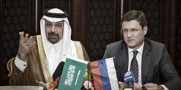 Khalid Bin Abdulaziz Al-Falih, Saudi Arabia's energy minister, left, speaks as Alexander Novak, Russia's energy minister, looks on during a news conference on the sidelines of the Belt and Road Forum for International Cooperation in Beijing, China, on Monday, May 15, 2017. Saudi Arabia and Russia said they favor prolonging oil-output cuts by global producers through the end of the first quarter of 2018, setting a firmer timeframe for a likely extension of the curbs into next year.Crude price