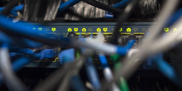 Network cables are seen going into a server in an office building in Washington, DC on May 13, 2017.  International investigators hunted on May 13 for those behind an unprecedented cyber-attack that affected systems in dozens of countries, including at banks, hospitals and government agencies, as security experts sought to contain the fallout. The assault, which began Friday and was being described as the biggest-ever cyber ransom attack, struck state agencies and major companies around the world -- from Russian banks and British hospitals to FedEx and European car factories. / AFP PHOTO / Andrew CABALLERO-REYNOLDS        (Photo credit should read ANDREW CABALLERO-REYNOLDS/AFP/Getty Images)