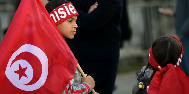 Tunisian children hold their national flags during a rally on January 14, 2016 in the Habib Bourguiba Avenue in the capital Tunis to mark the fifth anniversary of the 2011 revolution.Thousands gathered in the Tunisian capital to mark the fifth anniversary of the overthrow of longtime dictator Zine El Abidine Ben Ali in the uprising that inspired the Arab Spring. / AFP / FETHI BELAID        (Photo credit should read FETHI BELAID/AFP/Getty Images)